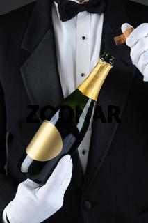 Sommelier Uncorking Champagne Bottle