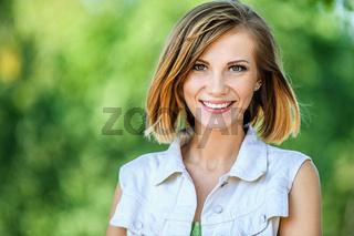 smiling beautiful young woman close-up