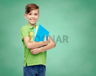 happy student boy with folders and notebooks