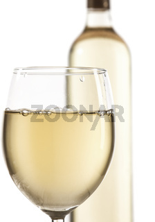 Wineglass and bottle with white wine