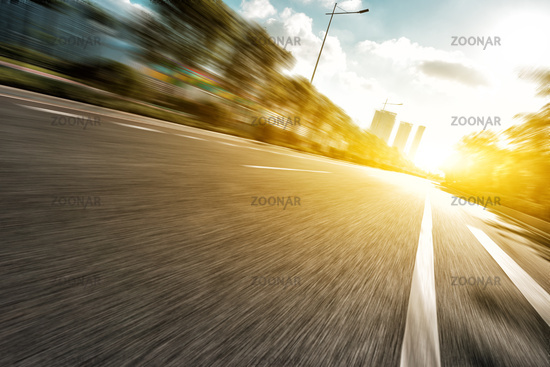 empty asphalt road under sunshine