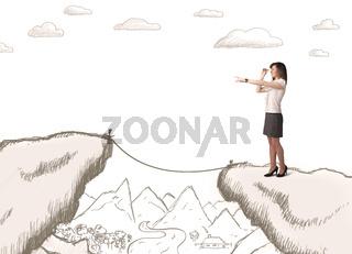 Businesswoman with drawn edge of mountain