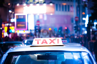 Hong Kong cityscape with taxi car