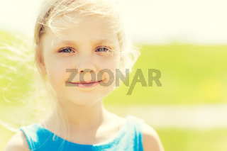 happy little girl outdoors at summer