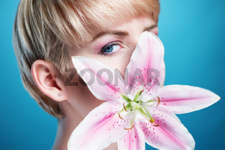 Pretty Face of a Blond Woman Covered with Flower