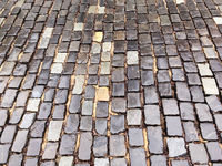 old wet granite cobblestone street in the rain