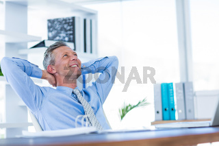 Businessman relaxing in swivel chair