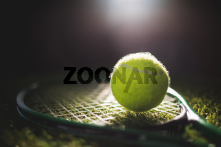 Close up of tennis ball with racket