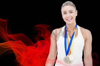 Composite image of female athlete wearing medals