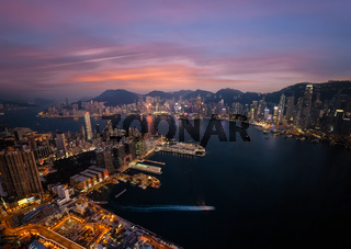 Hong Kong skyline and Victoria Harbor evening aerial view
