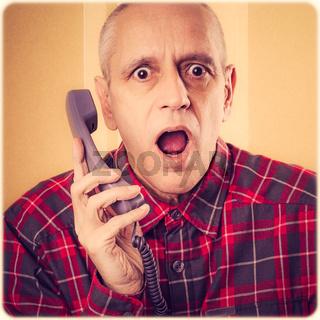 Man Surprised on Phone