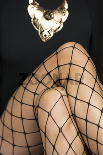 close up of female legs in fishnet stockings