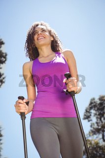 Fit woman hiking in the park