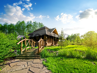 Wooden bridge and house