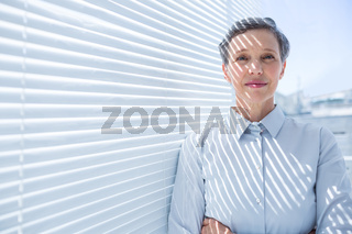 Smiling businesswoman standing in the office