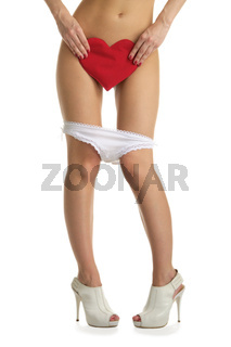 Female legs with white panties and heart