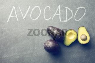 halved avocado on blackboard