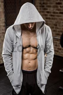 Muscular man wearing hood