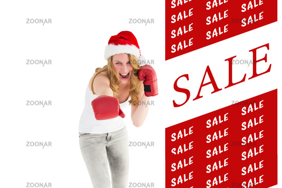 Composite image of festive blonde punching with boxing gloves
