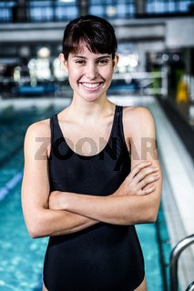 Smiling swimmer woman with arms crossed