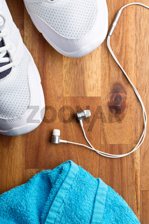 sport concept. headphones, shoes and towel