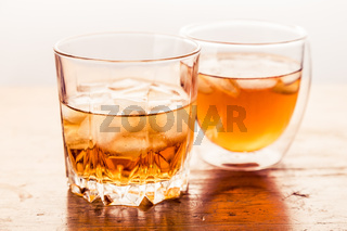 Two different glasses of whiskey