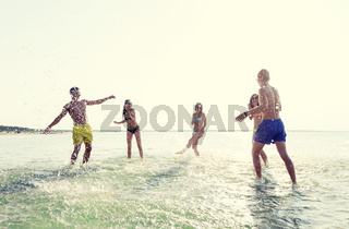 happy friends having fun on summer beach