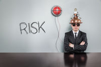 Risk text with alert light and vintage businessman