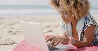 Girl Working On The Sand Beach