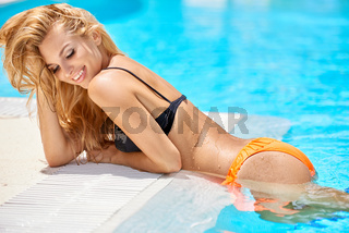 Sensual blond girl in swimming pool