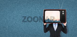 Composite image of businessman hiding head with a box