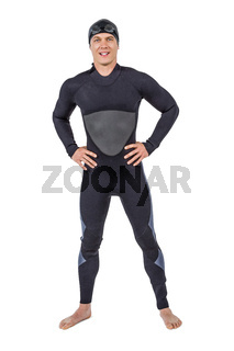 Portrait of confident swimmer in wetsuit
