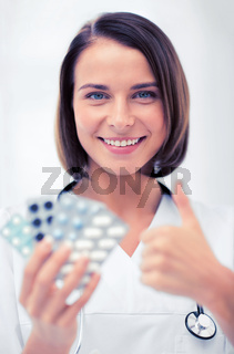 doctor with blister packs of pills
