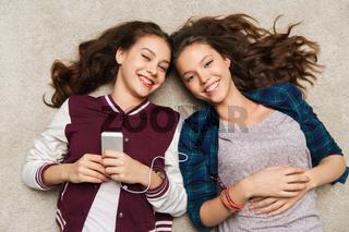 teenage girls listening to music on smartphone