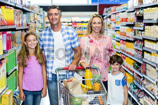 Happy family at the supermarket