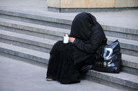 Beggar in Black Dress