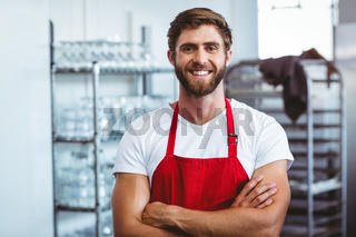 Handsome barista smiling at the camera