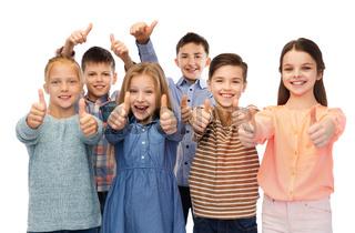 happy children showing thumbs up