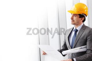 businessman in construction helmet