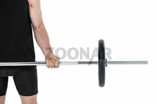 Bodybuilder lifting heavy barbell weights