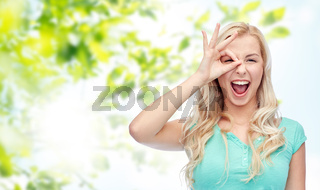 young woman making ok hand gesture