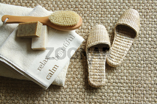 Straw slippers with spa accessories