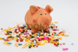 Tabletten und Sparschwein