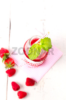 Healthy fruits smoothie drink with raspberries