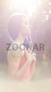 surreal blurred background of young woman