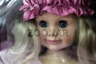 Closeup photograph of a single childs 's dolls face with nobody in the background
