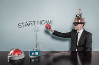 Start now concept with businessman holding brain