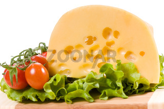 cherry tomatoes and yellow cheese with holes