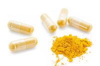 Turmeric powder and herbal capsules.