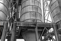Industrial cement silos in black and white, London, United Kingdom